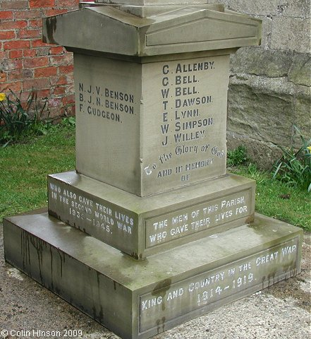 The World War I and II memorial in the churchyard at Great Ouseburn.
