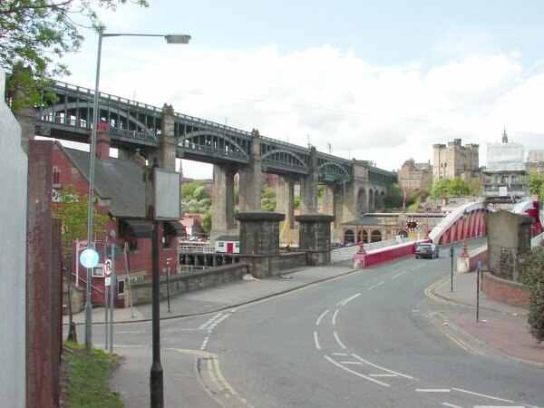The High Level Bridge (1854) and Swing Bridge (1876). The red-brick building on the left is the former River Police Station.