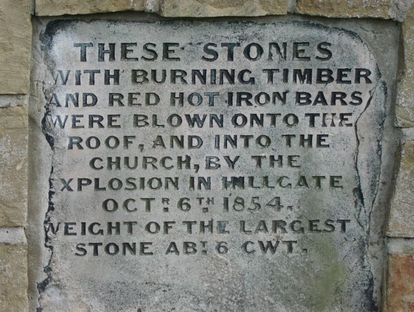Stone set into the north wall of St Mary's Churchyard.
