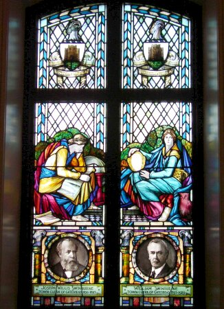 Commemorative Window above Town Hall door dedicated to Town Clerks Joseph Willis Swinburne and William Swinburne.