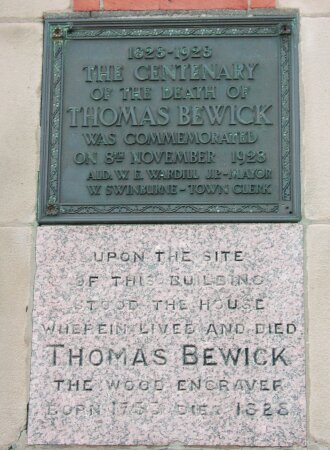 Commemorative plaque in the Post Office wall.