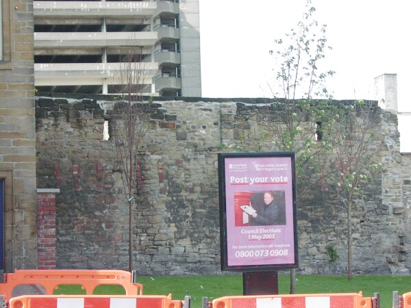 Wall adjacent to the Co-op built from stones from the windmill which formerly stood where New Century House now stands at the Jackson Street/West Street junction.
